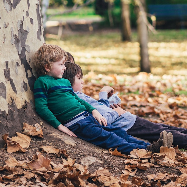 Pre-school child in a childminder setting enjoying and learning out of doors